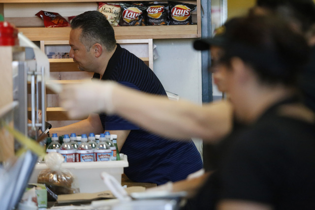 Luis Escobar, 42, left, takes a customer order at the George's Italian Deli on Friday, Feb. 3, 2017, in Las Vegas. Escobar is the owner of the deli. (Christian K. Lee/Las Vegas Review-Journal) @ch ...