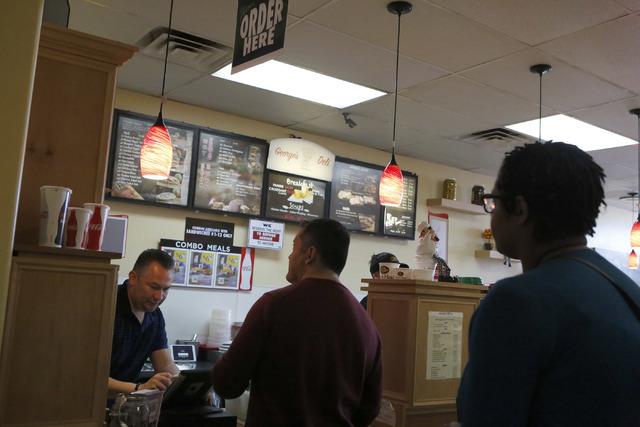 Luis Escobar, 42, left, takes customer orders at the George's Italian Deli on Friday, Feb. 3, 2017, in Las Vegas. (Christian K. Lee/Las Vegas Review-Journal) @chrisklee_jpeg