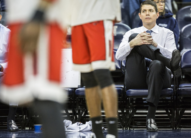 UNR assistant coach Dave Rice watches UNLV warm up before the start of the Wolf Pack's home matchup with UNLV on Wednesday, Feb. 8, 2017, at the Lawlor Events Center, in Reno. Rice was a player on ...