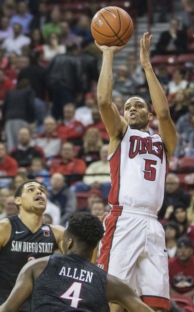 UNLV's Jalen Poyser (5) shoots a corner jump shot over San Diego State's Dakarai Allen (4) during the Rebels home matchup with the Aztecs on Tuesday, Jan. 17, 2017, at the Thomas & Mack Center ...