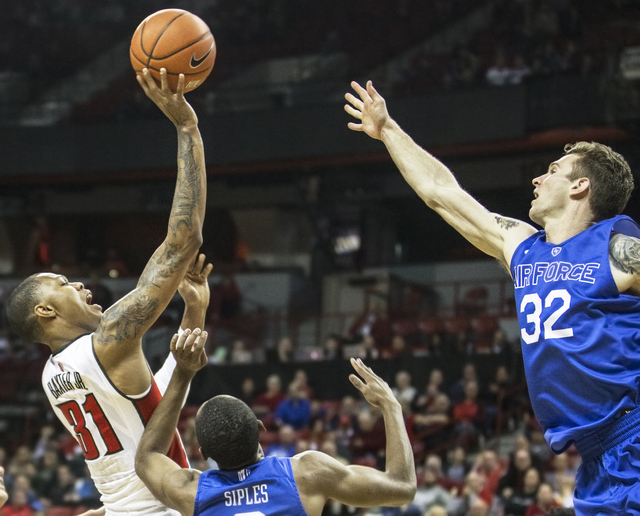 UNLV's Troy Baxter (31) shoots over Air Force's Ryan Manning (32) and CJ Siples (2) during the Rebels home matchup with the Falcons on Saturday, Jan. 21, 2017, at the Thomas & Mack Center, in  ...
