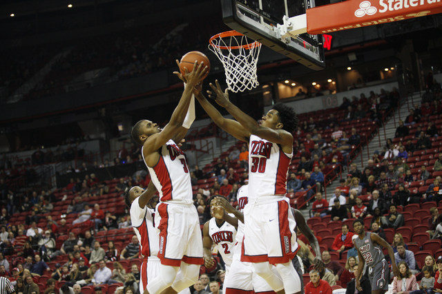UNLV Rebels forward Tyrell Green (3) and UNLV Rebels guard Jovan Mooring (30) go to catch a rebound during a game against Southern Illinois at the Thomas & Mack Center on Monday, Dec. 19, 2016 ...