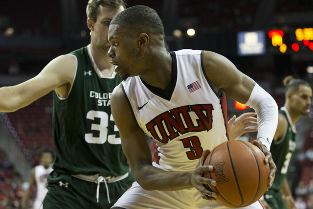 UNLV Rebels forward Tyrell Green (3) looks for an open pass against Colorado State Rams forward Braden Koelliker (33) in the men's basketball game at the Thomas & Mack Center on Saturday, Feb. ...