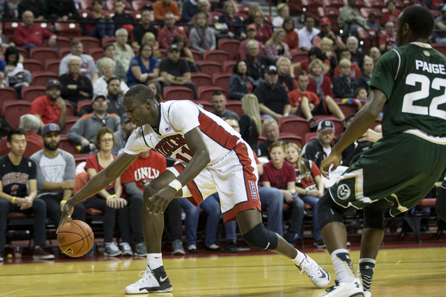 UNLV Rebels forward Cheickna Dembele (11) saves the ball from going out of bounds against Colorado State Rams in the men's basketball game at the Thomas & Mack Center on Saturday, Feb. 4, 2017 ...