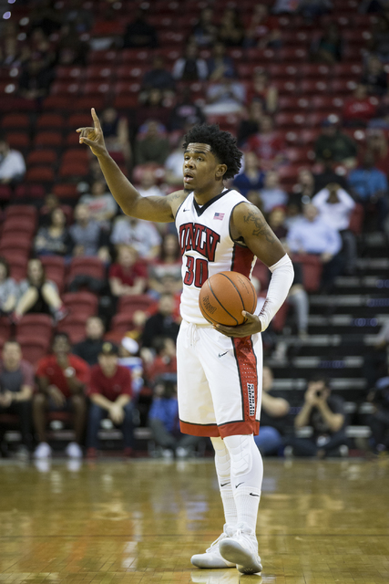 UNLV Rebels guard Jovan Mooring (30) looks for an open pass against Colorado State Rams in the men's basketball game at the Thomas & Mack Center on Saturday, Feb. 4, 2017, in Las Vegas. (Erik  ...