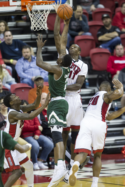 UNLV Rebels forward Cheickna Dembele (11) blocks a shot from Colorado State Rams forward Emmanuel Omogbo (2) in the men's basketball game at the Thomas & Mack Center on Saturday, Feb. 4, 2017, ...