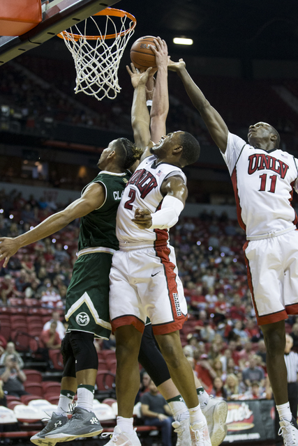 UNLV Rebels guard Uche Ofoegbu (2) and Cheickna Dembele (11) jump for a rebound against Colorado State Rams in the men's basketball game at the Thomas & Mack Center on Saturday, Feb. 4, 2017,  ...