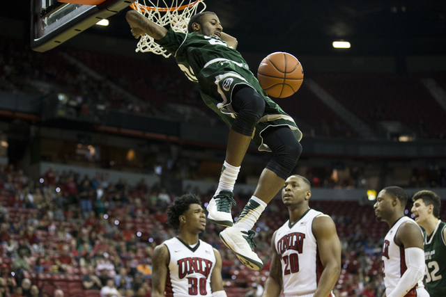 Colorado State Rams guard J.D. Paige (22) dunks the ball for a score against UNLV Rebels in the men's basketball game at the Thomas & Mack Center on Saturday, Feb. 4, 2017, in Las Vegas. Color ...