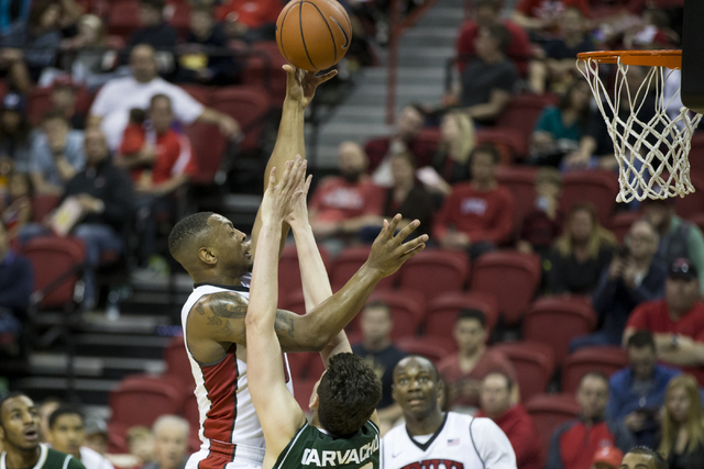UNLV Rebels forward Christian Jones (20) goes up for a shot against Colorado State Rams forward Nico Carvacho (32) in the men's basketball game at the Thomas & Mack Center on Saturday, Feb. 4, ...