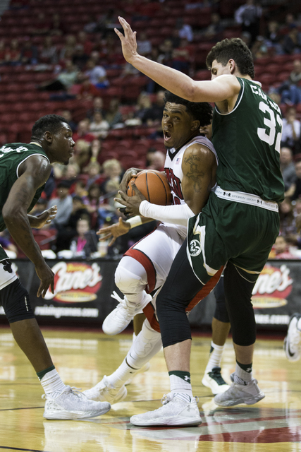 UNLV Rebels guard Jovan Mooring (30) drives the ball to the basket against Colorado State Rams forward Nico Carvacho (32) in the men's basketball game at the Thomas & Mack Center on Saturday,  ...