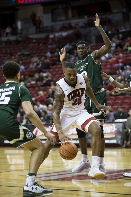 UNLV Rebels forward Christian Jones (20) drives the ball to the basket against Colorado State Rams in the men's basketball game at the Thomas & Mack Center on Saturday, Feb. 4, 2017, in Las Ve ...