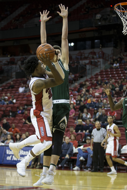 UNLV Rebels guard Jovan Mooring (30) goes up for a shot against Colorado State Rams in the men's basketball game at the Thomas & Mack Center on Saturday, Feb. 4, 2017, in Las Vegas. Colorado w ...