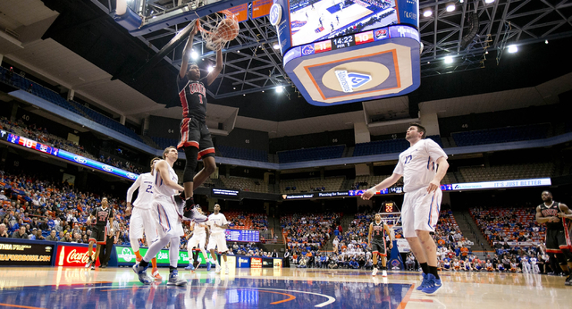 UNLV basketball player UNLV player Derrick Jones Jr. (1) dunks against the Boise State defense at Taco Bell Arena in Boise, Idaho, on Tuesday, Feb. 23, 2016. Boise State led UNLV 35-34 at halftime ...