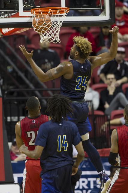 Nevada Wolf Pack guard Jordan Caroline (24) scores a basket against UNLV Rebels in their basketball game at the Thomas & Mack Center on Saturday, Feb. 25, 2017, in Las Vegas. Nevada Wolf Pack  ...