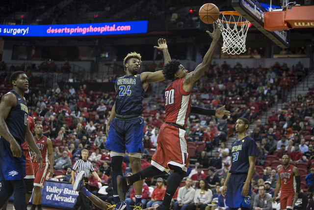UNLV Rebels guard Jovan Mooring (30) goes up for a shot against Nevada Wolf Pack in their basketball game at the Thomas & Mack Center on Saturday, Feb. 25, 2017, in Las Vegas. Nevada Wolf Pack ...