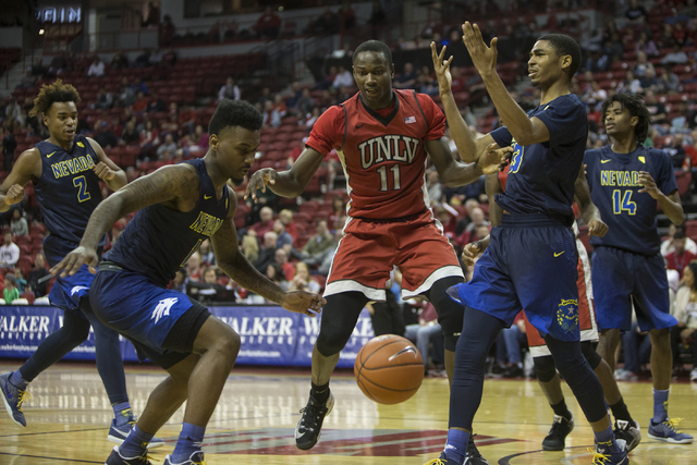UNLV Rebels forward Cheickna Dembele (11) is called for travel against Nevada Wolf Pack in their basketball game at the Thomas & Mack Center on Saturday, Feb. 25, 2017, in Las Vegas. Nevada Wo ...