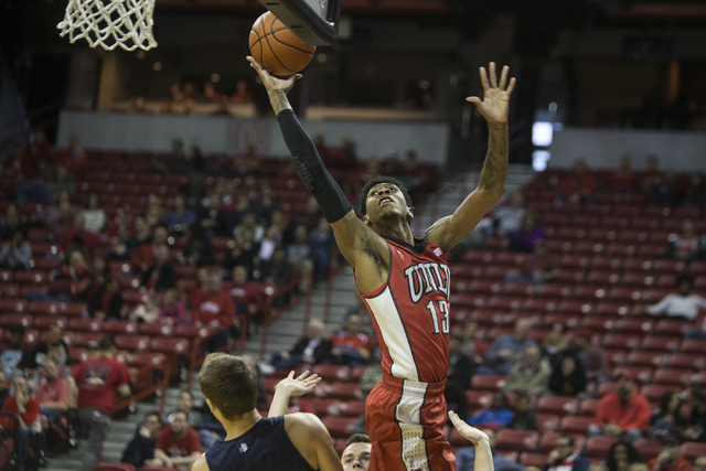 UNLV Rebels forward Ben Coupet Jr. (13) goes up for a shot against Nevada Wolf Pack in their basketball game at the Thomas & Mack Center on Saturday, Feb. 25, 2017, in Las Vegas. Nevada Wolf P ...