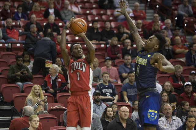 UNLV Rebels guard Kris Clyburn (1) takes a shot against Nevada Wolf Pack guard Marcus Marshall (1) in their basketball game at the Thomas & Mack Center on Saturday, Feb. 25, 2017, in Las Vegas ...