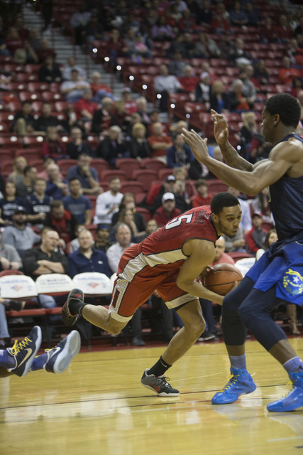 UNLV Rebels guard Jalen Poyser (5) stumbles as he drives to the basket against Nevada Wolf Pack in their basketball game at the Thomas & Mack Center on Saturday, Feb. 25, 2017, in Las Vegas. ( ...