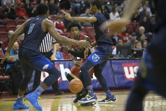 UNLV Rebels guard Jovan Mooring (30) makes a pass against Nevada Wolf Pack in their basketball game at the Thomas & Mack Center on Saturday, Feb. 25, 2017, in Las Vegas. (Erik Verduzco/Las Veg ...