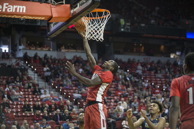 UNLV Rebels forward Cheickna Dembele (11) goes up for a lay-up against Nevada Wolf Pack in their basketball game at the Thomas & Mack Center on Saturday, Feb. 25, 2017, in Las Vegas. (Erik Ver ...