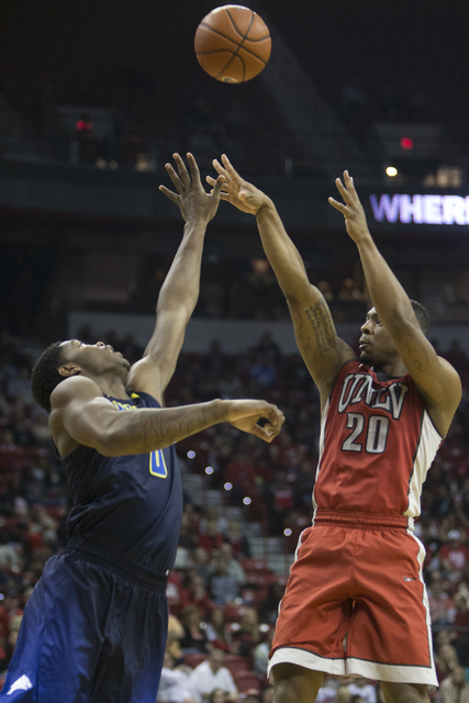 UNLV Rebels forward Christian Jones (20) takes a shot against Nevada Wolf Pack forward Cameron Oliver (0) in their basketball game at the Thomas & Mack Center on Saturday, Feb. 25, 2017, in La ...