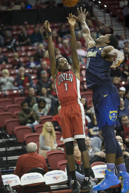 UNLV Rebels guard Kris Clyburn (1) takes a shot against Nevada Wolf Pack forward Cameron Oliver (0) in their basketball game at the Thomas & Mack Center on Saturday, Feb. 25, 2017, in Las Vega ...