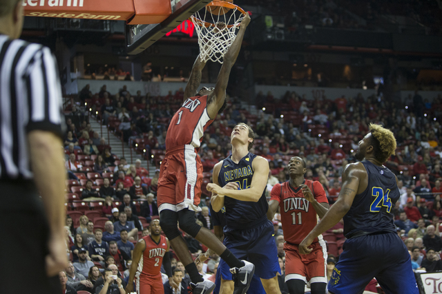 UNLV Rebels guard Kris Clyburn (1) dunks the ball against Nevada Wolf Pack in their basketball game at the Thomas & Mack Center on Saturday, Feb. 25, 2017, in Las Vegas. (Erik Verduzco/Las Veg ...