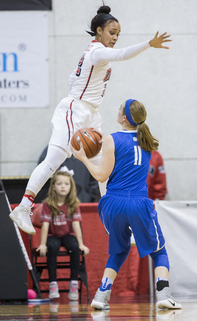 UNLV's Dakota Gonzalez (12) leaps to block the shot of Air Force's Kailin Davis (11) during the Rebels home matchup with the Falcons on Wednesday, Feb. 22, 2017, at Cox Pavilion, in Las Vegas.  (B ...