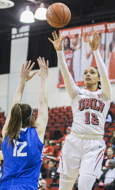 UNLV's Dakota Gonzalez (12) shoots a corner jump shot over Air Force's Kailin Davis (12) during the Rebels home matchup with the Falcons on Wednesday, Feb. 22, 2017, at Cox Pavilion, in Las Vegas. ...
