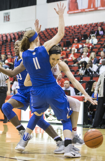 UNLV's  Brooke Johnson (2) collides with Air Force's Cortney Porter (11) on the way to the basket during the Rebels home matchup with the Falcons on Wednesday, Feb. 22, 2017, at Cox Pavilion, in L ...
