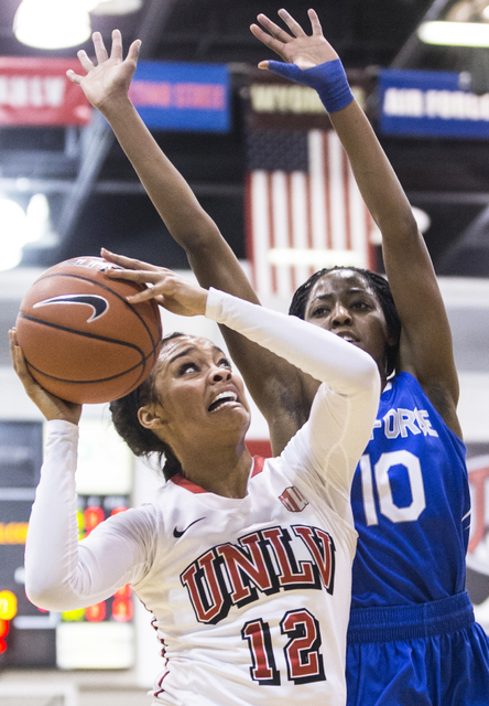UNLV's Dakota Gonzalez (12) drives past Air Force's Venessannah Itugbu (10) during the Rebels home matchup with the Falcons on Wednesday, Feb. 22, 2017, at Cox Pavilion, in Las Vegas.  (Benjamin H ...