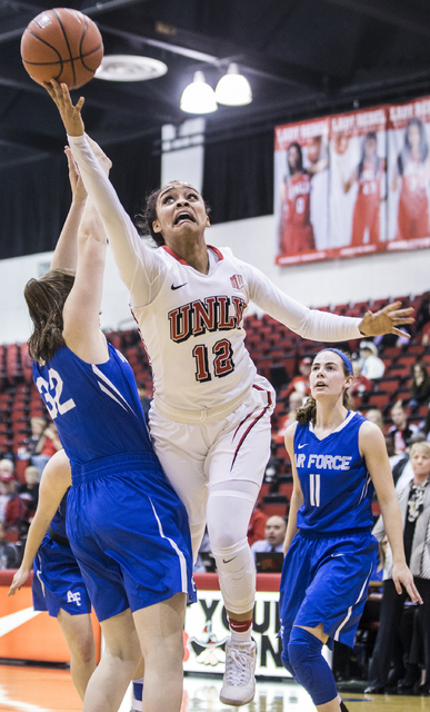 UNLV's Dakota Gonzalez (12) slices to the rim past Air Force's Darby Glaab (32) during the Rebels home matchup with the Falcons on Wednesday, Feb. 22, 2017, at Cox Pavilion, in Las Vegas.  (Benjam ...