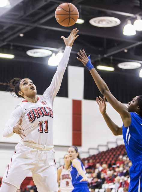 UNLV's Dylan Gonzalez (11) shoots a jump hook over Air Force's Venessannah Itugbu (10) during the Rebels home matchup with the Falcons on Wednesday, Feb. 22, 2017, at Cox Pavilion, in Las Vegas.   ...