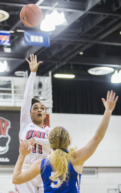 UNLV's Dylan Gonzalez (11) shoots a jump hook over Air Force's Sarah Falvey (5) during the Rebels home matchup with the Falcons on Wednesday, Feb. 22, 2017, at Cox Pavilion, in Las Vegas.  (Benjam ...