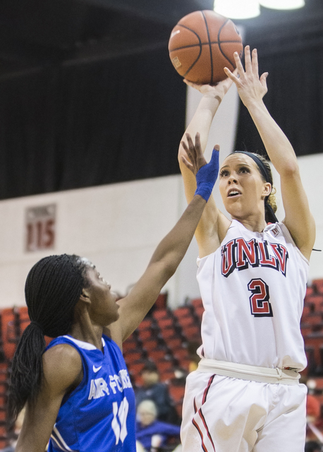 UNLV's Brooke Johnson (2) shoots a corner jump shot over Air Force's Venessannah Itugbu (10) during the Rebels home matchup with the Falcons on Wednesday, Feb. 22, 2017, at Cox Pavilion, in Las Ve ...