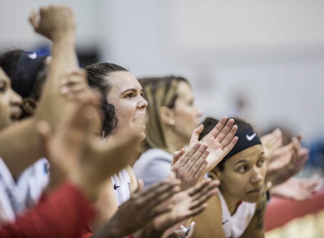 UNLV's bench erupts after the Rebels convert a three point play during their home matchup with Air Force on Wednesday, Feb. 22, 2017, at Cox Pavilion, in Las Vegas.  (Benjamin Hager/Las Vegas Revi ...