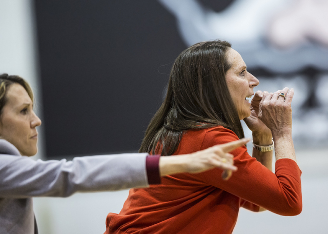 UNLV head coach Kathy Olivier, right, and assistant coach  Caitlin Collier direct their team during the Rebels home matchup with Air Force on Wednesday, Feb. 22, 2017, at Cox Pavilion, in Las Vega ...