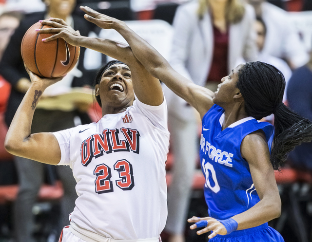 UNLV's Jordyn Bell (23) drives to the basket over Air Force's Venessannah Itugbu (10) during the Rebels home matchup with the Falcons on Wednesday, Feb. 22, 2017, at Cox Pavilion, in Las Vegas.  ( ...