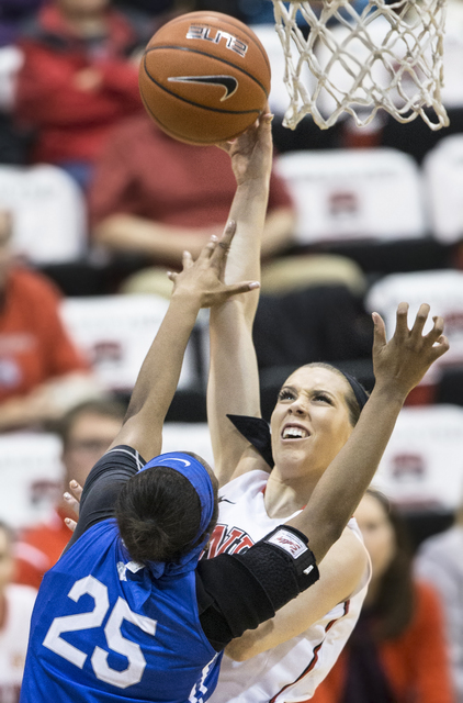 UNLV's Brooke Johnson (2) shoots a baseline runner over Air Force's Erika Chapman (25) during the Rebels home matchup with the Falcons on Wednesday, Feb. 22, 2017, at Cox Pavilion, in Las Vegas.   ...