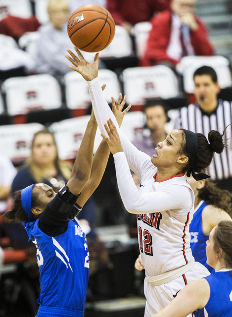 UNLV's Dakota Gonzalez (12) slices to the basket past Air Force's Erika Chapman (25) during the Rebels home matchup with the Falcons on Wednesday, Feb. 22, 2017, at Cox Pavilion, in Las Vegas.  (B ...