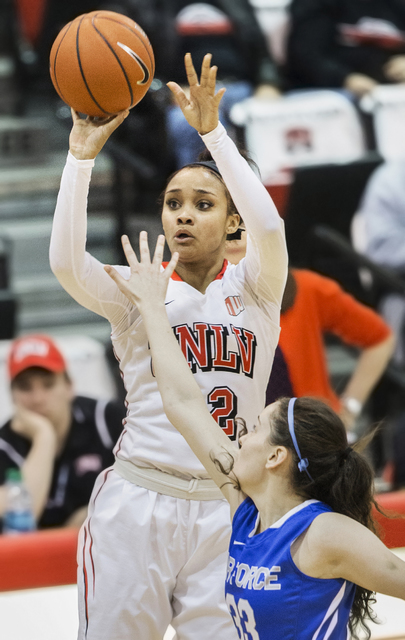 UNLV's Dakota Gonzalez (12) shoots a jump shot over Air Force's Mariah Forde (33) during the Rebels home matchup with the Falcons on Wednesday, Feb. 22, 2017, at Cox Pavilion, in Las Vegas.  (Benj ...