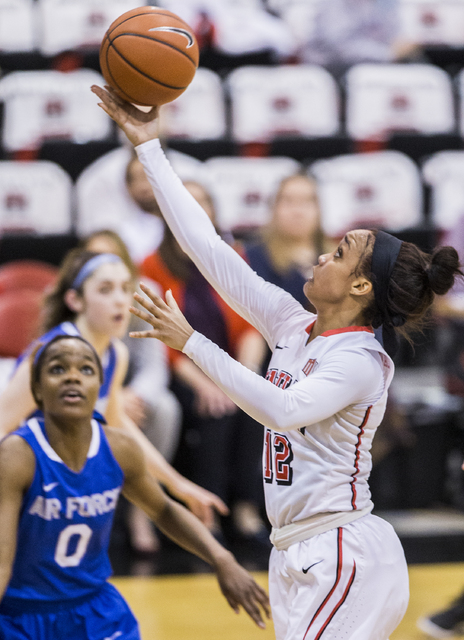 UNLV's Dakota Gonzalez (12) slices to the basket past Air Force's Dee Bennett (0) during the Rebels home matchup with the Falcons on Wednesday, Feb. 22, 2017, at Cox Pavilion, in Las Vegas.  (Benj ...