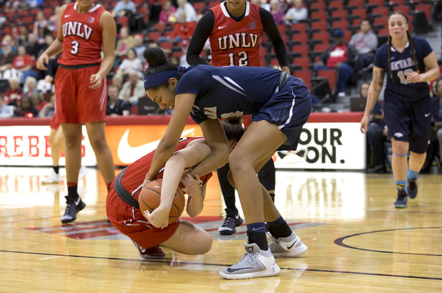 UNLV Rebels forward Alyssa Anderson (20) and Nevada Wolf Pack forward AJ Cephas (32) fight for the ball at Cox Pavilion at UNLV campus on Wednesday, Feb. 8, 2017, in Las Vegas. (Bridget Bennett/La ...