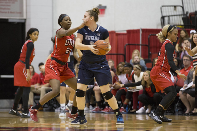 Nevada Wolf Pack forward Teige Zeller (3) looks for someone to pass to while UNLV Rebels center Rodjanae Wade (24) attempts to guard at Cox Pavilion at UNLV campus on Wednesday, Feb. 8, 2017, in L ...