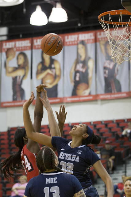 Nevada Wolf Pack forward AJ Cephas (32) attempts to block UNLV Rebels center Rodjanae Wade (24) attempts a shot at Cox Pavilion at UNLV campus on Wednesday, Feb. 8, 2017, in Las Vegas. (Bridget Be ...
