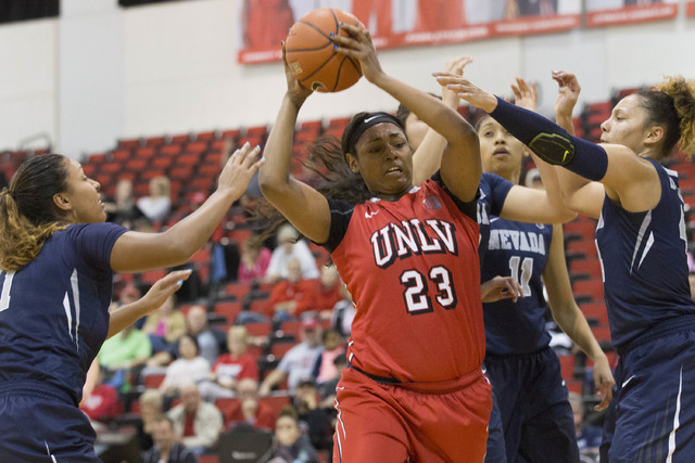 UNLV Rebels forward Jordyn Bell (23) attempts to shoot the ball against Nevada Wolf Pack at Cox Pavilion at UNLV campus on Wednesday, Feb. 8, 2017, in Las Vegas. (Bridget Bennett/Las Vegas Review- ...