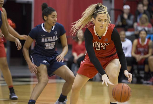 UNLV Rebels center Katie Powell (21) handles the ball at Cox Pavilion at UNLV campus on Wednesday, Feb. 8, 2017, in Las Vegas. (Bridget Bennett/Las Vegas Review-Journal) @bridgetkbennett