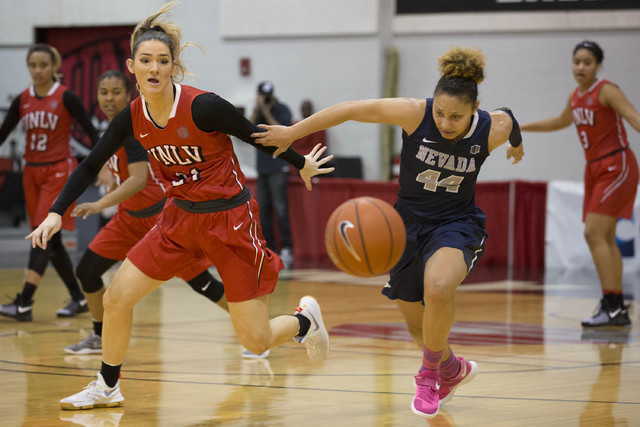 UNLV Rebels center Katie Powell (21) and Nevada Wolf Pack guard Riana Everidge (44) chance after the ball at Cox Pavilion at UNLV campus on Wednesday, Feb. 8, 2017, in Las Vegas. (Bridget Bennett/ ...