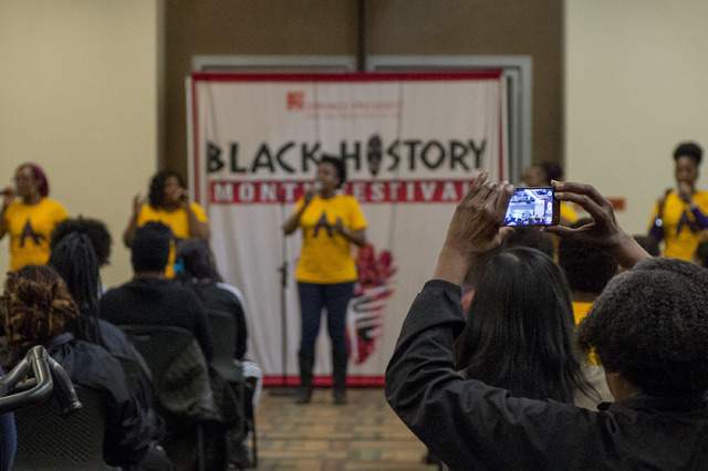 An audience member takes a photo as the New Antioch Christian Fellowship Praise Team performs for a large crowd during the Black History Month Festival at Springs Preserve on Saturday, Feb. 18, 20 ...